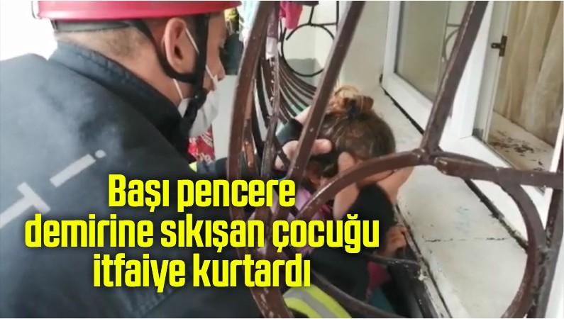Başı pencere demirine sıkışan çocuğu itfaiye kurtardı